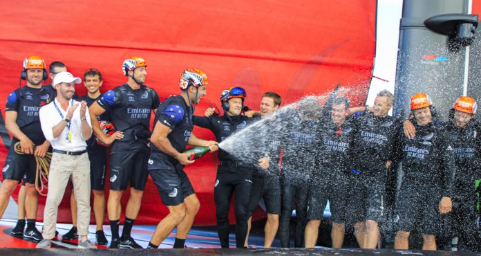 36th America's Cup presented by Prada Race Day 3 Mike Lee sprays champagne as Emirates Team New Zealand celebrate their America's Cup World Series win